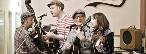 The Zazou Cowboys play a range of styles and sounds, from western swing and hillbilly tunes to jazzy swing and cowboy ballads. The name comes from a blend